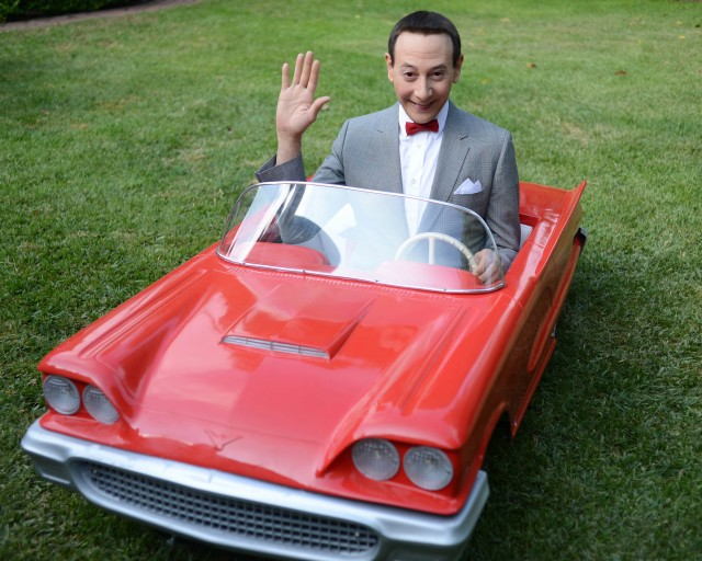 Pee-wee Herman in a miniature red car!!!!