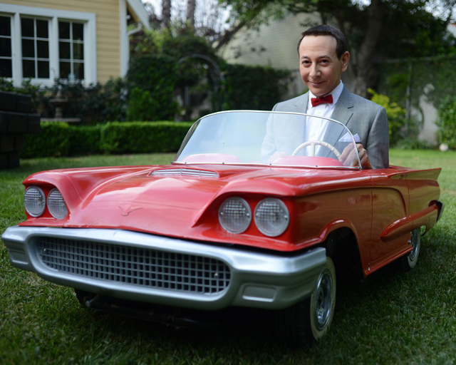 Pee-wee Herman in a little red car